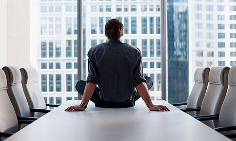 Businessman sitting on conference room table